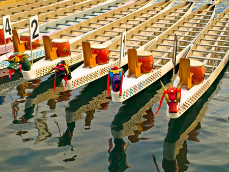 Dragon boats in a warm evening sunlight before the race Stock Photo