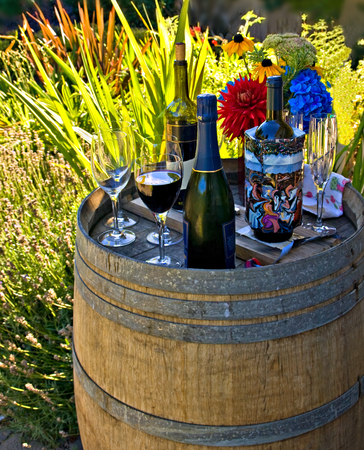 Drinks prepared in a backyard at the barrel decorated as a serving table Stock Photo