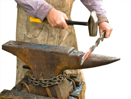 Blacksmith working on a metal detail, hand with hammer blurred in motion, isolated Imagens