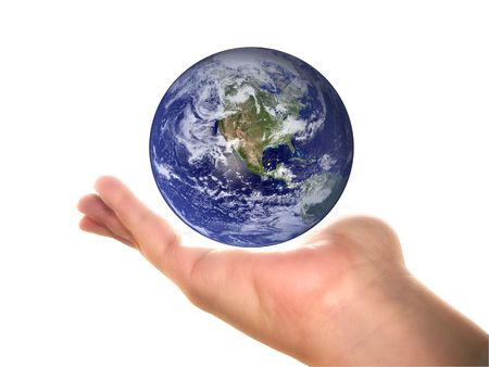 Earth on an open womans palm, over white