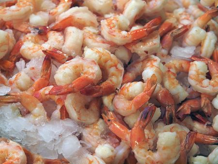 Cooked tail-on shrimp on ice on farm market booth