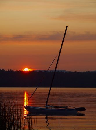 lave: Sailboat anchored at the lave during beautiful sunset