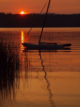 lave: Sailboat anchored at the lave during beautiful sunset  Stock Photo