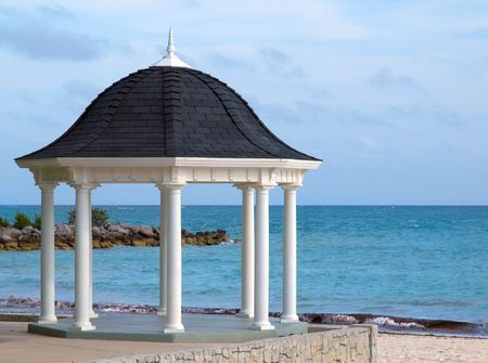 White gazebo for weddings overlooking tropical beach
