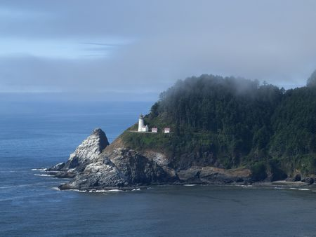 Heceta Head Lighthouse perches on the rocky shore of the Pacific Ocean