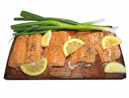 Salmon fillet cooked on a cedar plank in barbeque Imagens