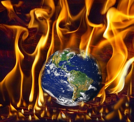 Earth globe scorched in fire symbolizing global warming Stock Photo