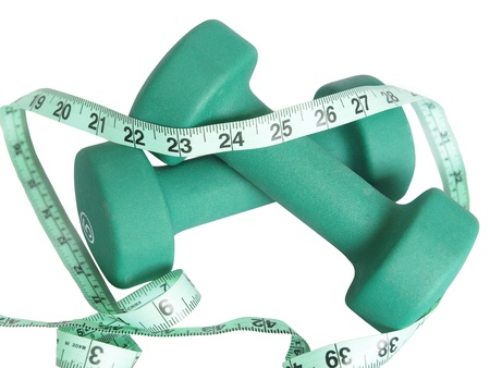 Set of dumbells with measuring tape over white Stock Photo - 9653758