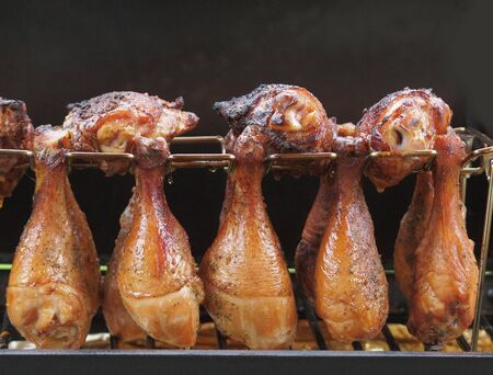 Portion of chicken drumsticks cooked on a charcoal smoker Reklamní fotografie