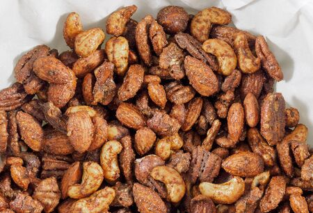 Roasted nuts mix piled  on paper napkin