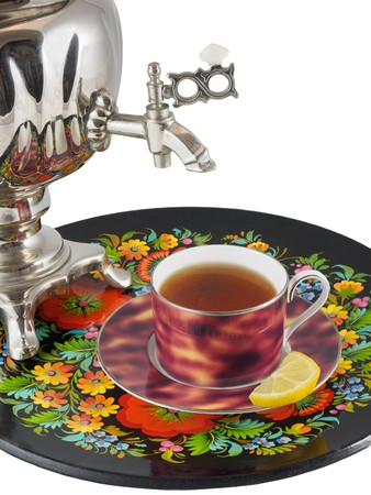 souvenir: Traditional Russian samova with cup of tea and lemon on a side  on a tray isolated over white