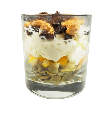 Homemade parfait with cultured cream or yougurt, nuts and seeds