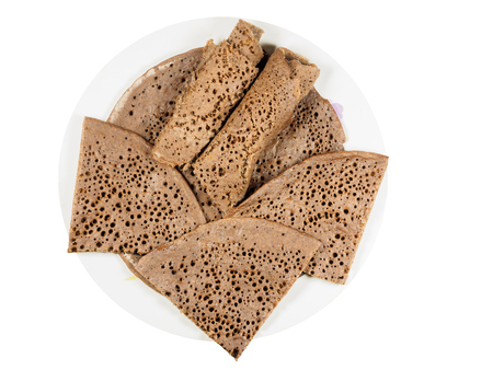 Traditional Ethiopian flatbread from fermented teff flour on a white plate, cut and rolled up Reklamní fotografie