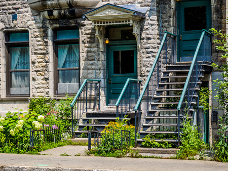 Typical Montreal neighborhood street with staircases Stock Photo