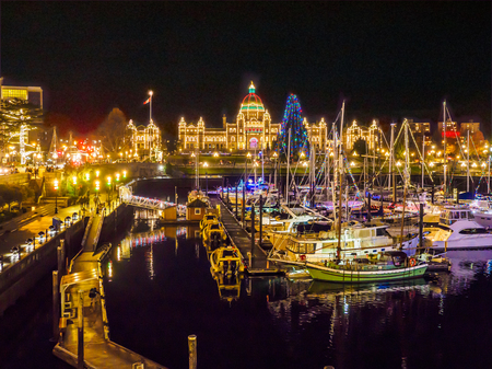 Inner Harbor of Victoria BC, capital of British Columbia, Vancouver Island, Canada, illuminated at  Christmas and New Year time