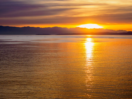 Sunset at the breakwater in Victoria BC, Canada Stock Photo