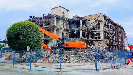 Demolition of the old building in urban setting