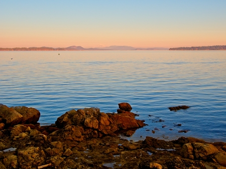 Tranquil sunset with moon rising at the shore in Sidney, British Columbia, Vancouver Island Stok Fotoğraf