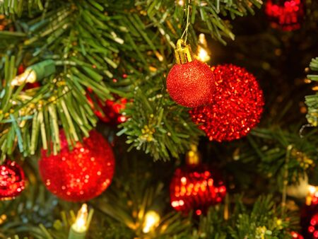 Christmas tree decorated with glitter, lights and glass balls for the Christmas and New Year celebrations Stock Photo