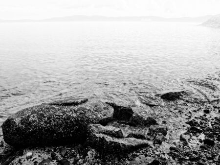 Rocky shore and heavy fog at the Public Ruckle Provincial Park shoreline on the Salt Spring Island, largest of the Gulf Islands in British Columbia 写真素材