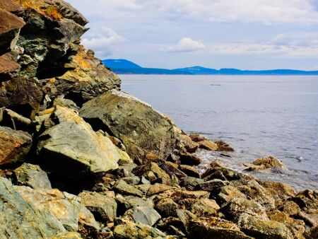 Rocky shore of the pPublic Ruckle Provincial Park shoreline on the Salt Spring Island, largest of the Gulf Islands in British Columbia