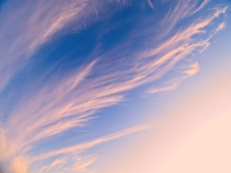 Beautiful formation of wispy clouds at the sunset time 스톡 콘텐츠