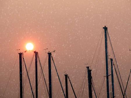 Rare snow in Sidney BC, Vancouver Island. Gloomy skies with reddish sun Stok Fotoğraf