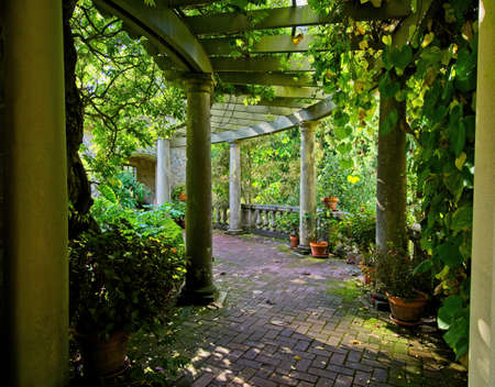 Public grounds of Hatley park in Victoria BC, Vancouver Island. Old Italian style gallery with autumn greenery