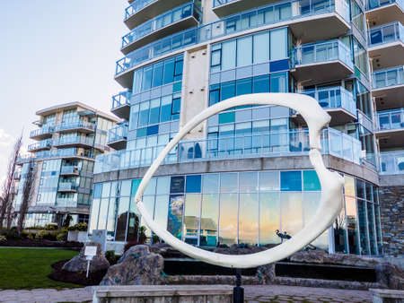 Sidney, BC Canada - March 16, 2018. Sculpture Eye of the Ocean at the lawn of the Sidney Pier Hotel
