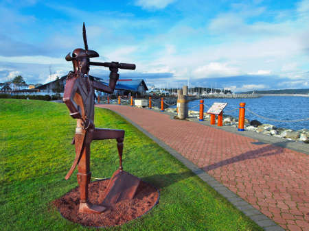 Sidney, BC Canada - June 18, 2018. Sculpture of the pirate at the lawn of the Sidney Pier Hotel
