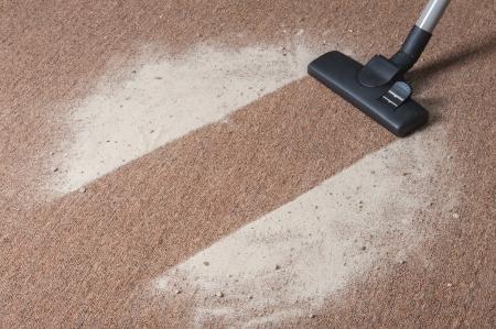 Vacuum cleaning dirt on a carpet Archivio Fotografico