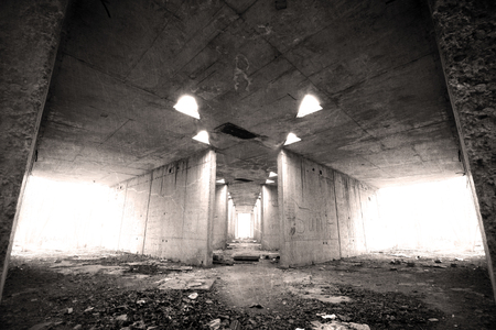 corridors: Destroyed, old and abandoned building, with corridors, garbage and writings on the walls