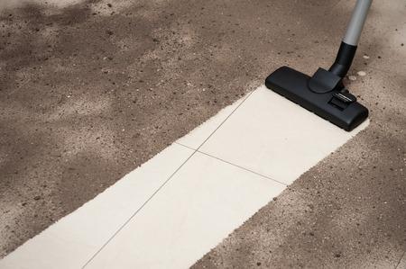 Vacuum cleaning tiled floor Standard-Bild