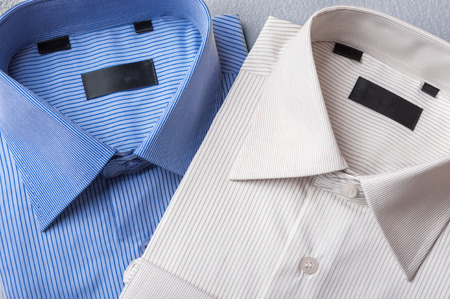 formal shirt: Studio shot of couple of mans shirts on a grey background Stock Photo