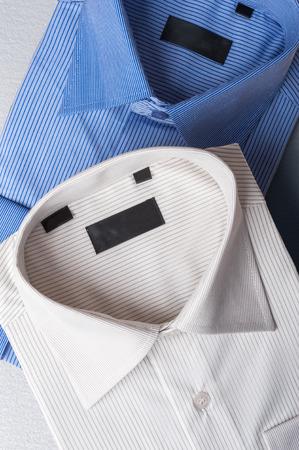 Studio shot of couple of mans shirts on a grey background 版權商用圖片