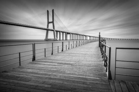 Black and white long exposure photo of the Vasco da Gama bridge in Lisbon, Portugal