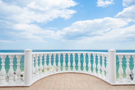 Balcony view on the sea shore on a sunny day Stok Fotoğraf