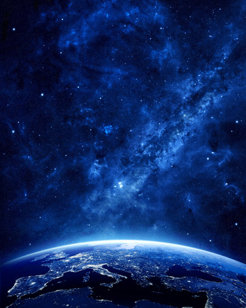 blue stars: Earth at night as seen from space with blue, glowing atmosphere and space at the top. Perfect for illustrations.  Elements of this image furnished by NASA