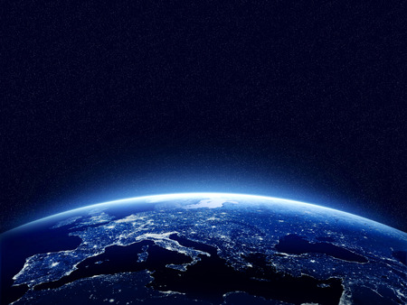 planet earth: Earth at night as seen from space with blue, glowing atmosphere and space at the top. Perfect for illustrations.  Elements of this image furnished by NASA