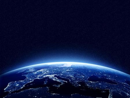 horizonte: Tierra en la noche vista desde el espacio con el azul, atm�sfera brillante y el espacio en la parte superior. Perfecto para las ilustraciones. Los elementos de esta imagen proporcionada por la NASA