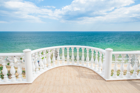 Balcony view on the sea shore on a sunny day Banco de Imagens