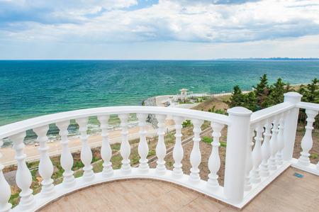 Balcony view on the sea shore on a sunny day Standard-Bild