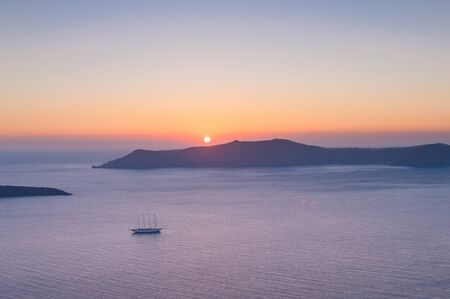 caldera: Sunset over Caldera volcano with a ship on the foreground. Santorini, Greece