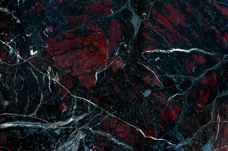 onyx: Black marble onyx texture with white cracks and red spots Stock Photo