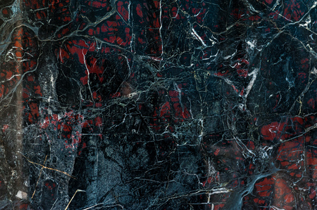 black onyx: Black marble onyx texture with white cracks and red spots Stock Photo