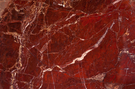 Red marble onyx texture with brown and white stripes and cracks Standard-Bild