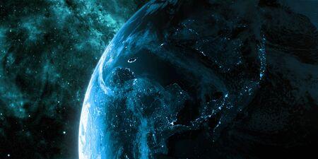 밤에 볼 도시의 불빛과 함께 어둠에 빛나는 지구. 행성은 구름으로 덮여있다. 아시아 지역. 파란색과 시안 색 구성표. 스톡 콘텐츠