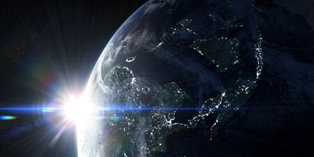 View on the night Earth with city lights. Sunrise in space with prominent sun flare and sun streaks. Asia region. 3d illustration 版權商用圖片