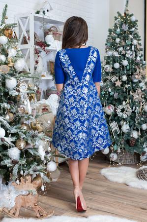Luxury christmas woman in fashion interior 版權商用圖片