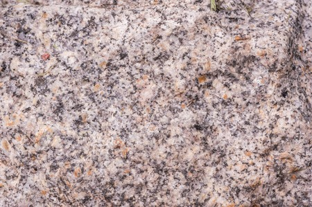 Macro closeup shot of the granite texture with black veins
